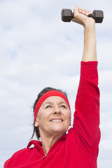 Positive successful mature woman exercising