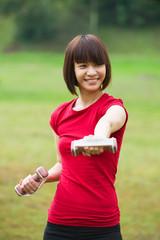asian girl dumbbell workout outdoor