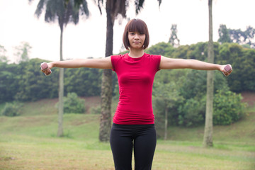 asian girl dumbbell workout outdoor