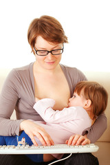 Young woman breastfeeds her baby