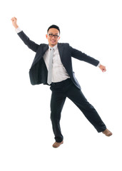 cheerful businessman dancing in success over a white background