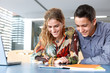 Young couple looking at a digital tablet