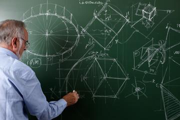 Professor teaching with blackboard