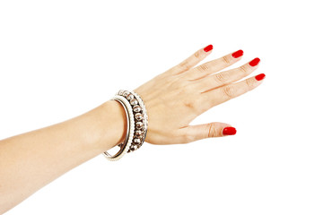Woman hand with silver bangles on white