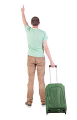 back view of  man  with suitcase.
