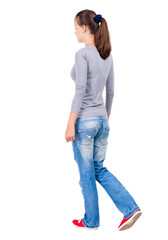 back view of walking  woman.