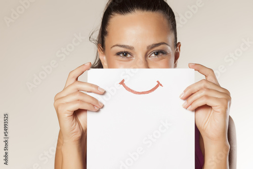 happy and smiling girl with a smile painted on paper - 54993525