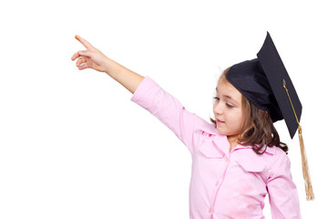 Young girl in graduation cap and gown pointing