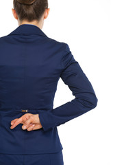 Business woman holding crossed fingers behind back . rear view