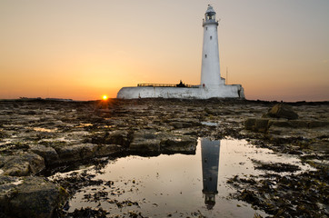 Reflected St Marys Lighthouse at sunset