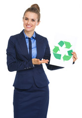 Happy business woman showing recycle sign