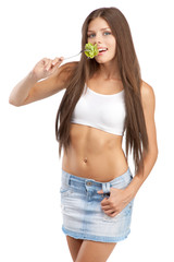 Young woman eating green salad