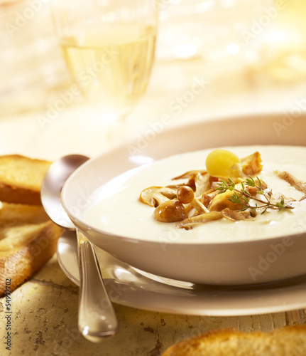 delicious mushroom soup with bread and wine