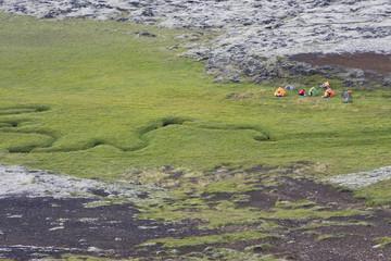 Island unter Mountainbiker einen Rest auf Gras