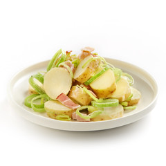 tasty potato salad with leek and bacon