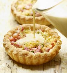 tasty quiche beeing prepared for dinner