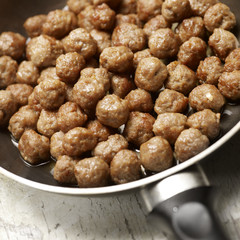 tasty meatballs beeing prepared in a frying pan