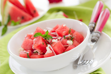 Salad with watermelon, cheese and mint.