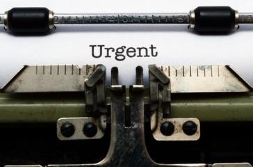 Urgent text on typewriter