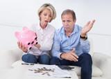 Shocked Couple Holding Piggybank