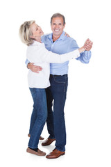 Portrait Of Mature Couple Dancing
