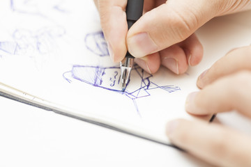 male designer drawing a character