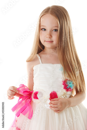 Cute little girl posing in beautiful pink dress