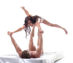 Cheerful young lovers playing in bed, close-up