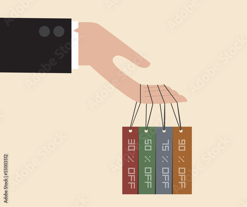 Businessman hand hang with discount tag