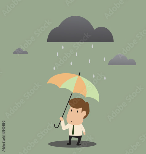 Businessman under an umbrella in the rain