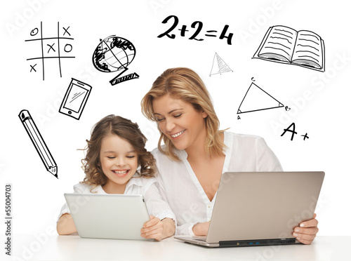 girl and mother with tablet and laptop