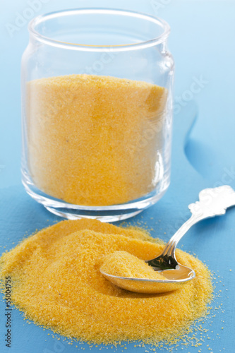 Corn flour, polenta on a blue background.