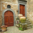 two antique doors in italian village Civita di Bagnoregio