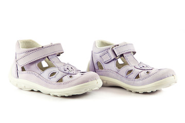 purple sandals for kids. children's shoes isolated on a white ba