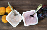 Yoghurts on the wooden table