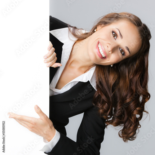 Businesswoman showing signboard