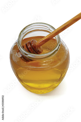 Honey with wood stick , isolated on white background