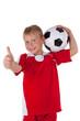 lachender Junge mit Fussball
