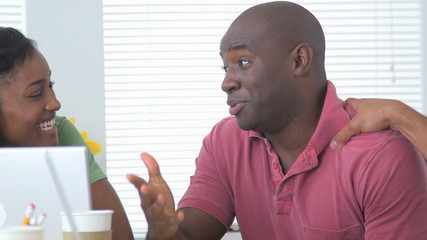 Black business partners talking in a meeting