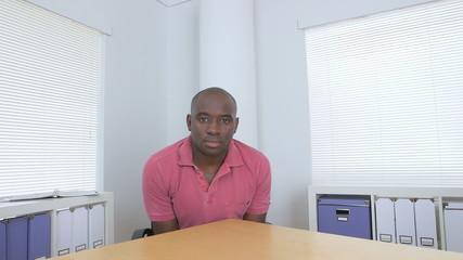 Black businessman sitting at desk