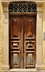 Old door facade in city of Rethymno, Crete, Greece