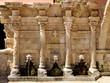 Leinwanddruck Bild - Old venetian fountain in city of Rethymno, Crete, Greece