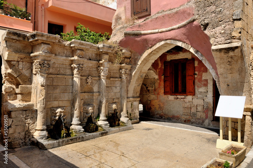 Old venetian fountain in city of Rethymno, Crete, Greece - 55009511