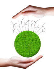 Green planet with wind turbines.Green energy concepts