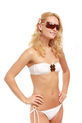 A young woman wearing sunglasses, isolated on white