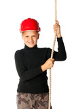boy builder in helmet holding a rope