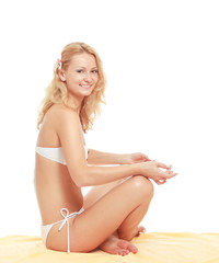 A young woman meditating on the beach, isolated on white