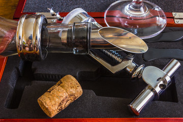 The bottle with corkscrew and wine accessories