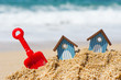 canvas print picture - Beach huts and toys