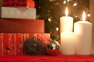 Christmas presents by candles
